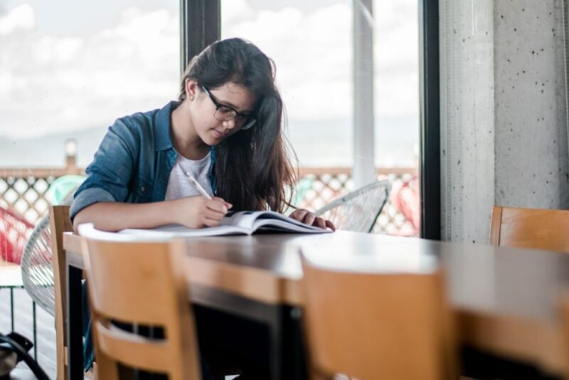 A college student studying with a text book